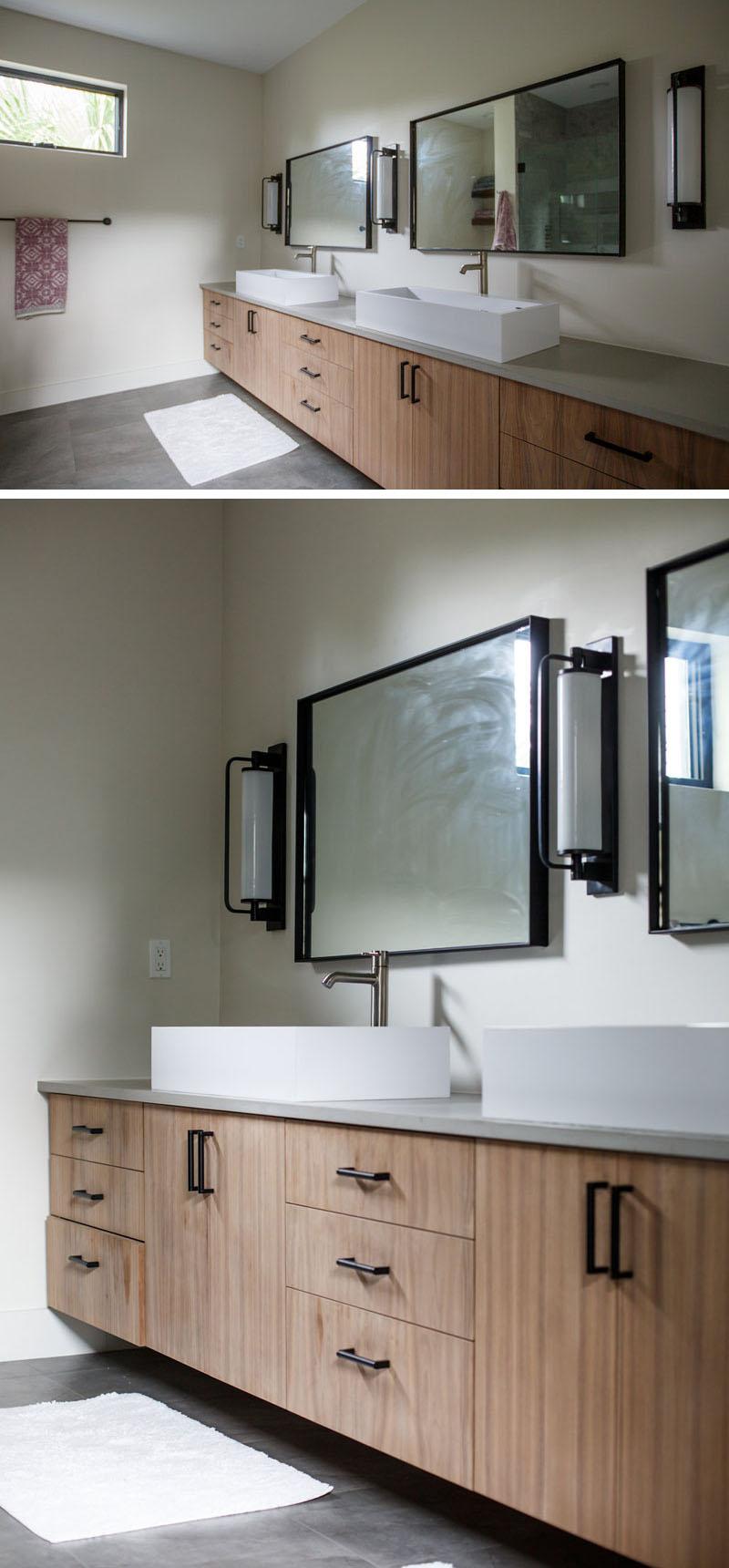 Современная ванная комната с белой столешницей и бетонным полом
