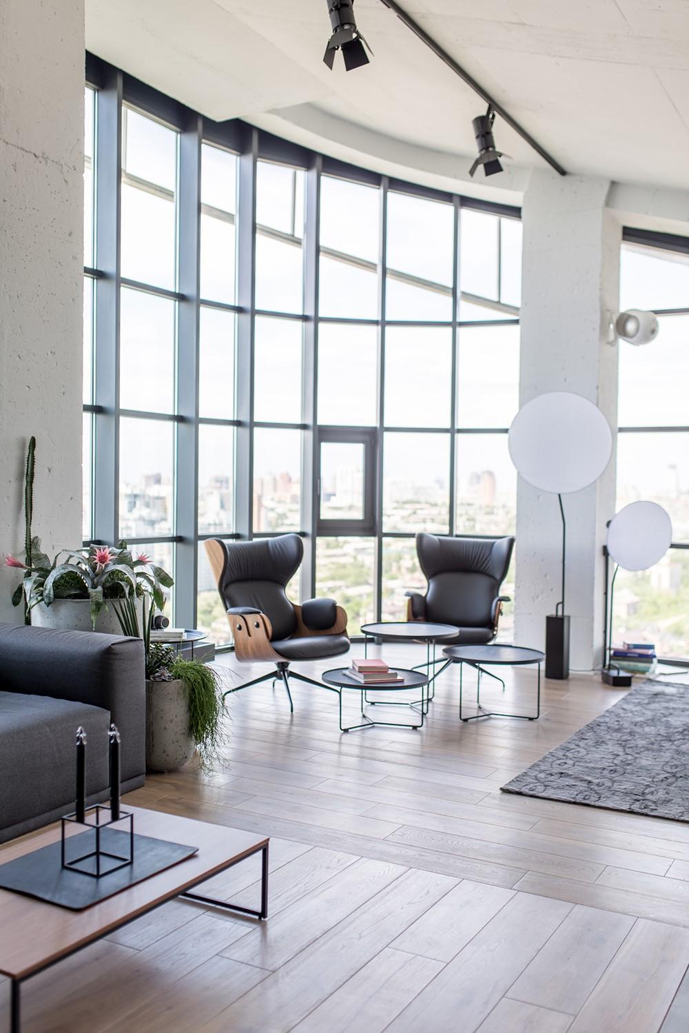Современный дизайн интерьера гостиной апартаментов в промышленном стиле