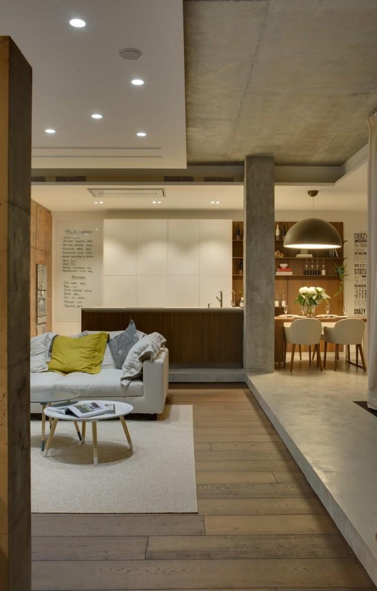 Современный дизайн интерьера гостиной апартаментов в индустриальном стиле